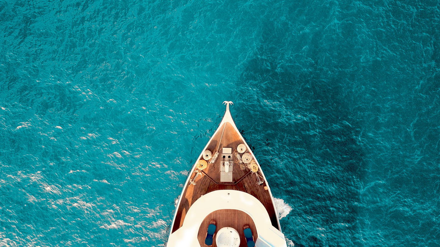 Aerial view of boat in clear blue water