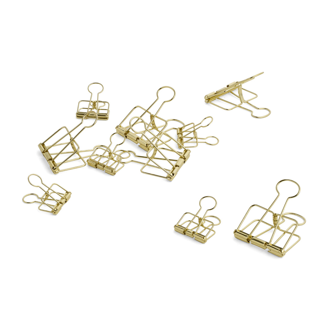 Outline paper clips in gold