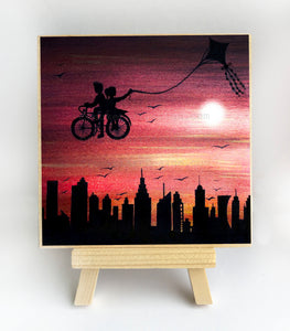 Kite bike ride above the city - sunset - silhouette - original miniature art Print on 4 x 4 wood-Print-Easel Wood-PocketArtDesigns-Original Art-wall rt