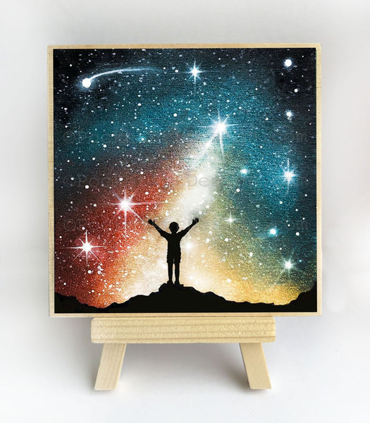 Grateful child - standing on rock in front of galaxy - silhouette - original miniature art print on 4 x 4 wood-Print-Easel Wood-PocketArtDesigns-Original Art-wall rt