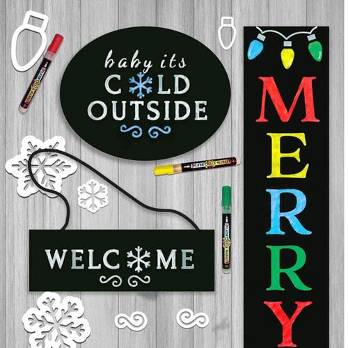 Christmas DIY Craft Kits for making stenciled Holiday door signs. Shows 3 stenciled signs- hanging welcome door sign, Baby it's cold Outside Sign, and Merry and Bright Vertical Porch sign chalkboard
