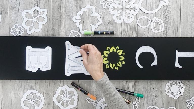 Remove the large letter stencils from board to reveal a DIY Welcome Sign porch Chalkboard