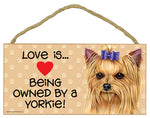 Load image into Gallery viewer, Love is Being Owned by a ... Wooden Sign