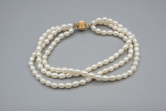 Triple Strand Natural Pearls with Large 14K Yellow Gold Ribbed Clasp