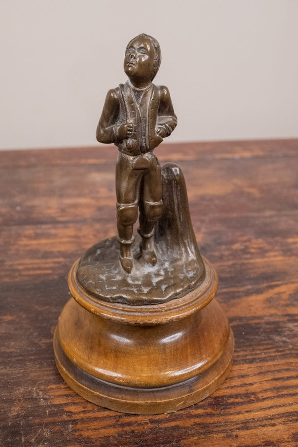 Bronze Statue of Boy on Wood Base