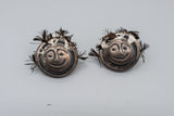 Signed Silver Face Earrings with Feathers