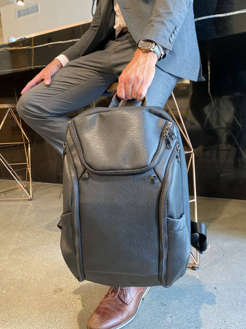 Dylan Sky DTLA backpack looks good with a wetsuit or a business suit. Features customizable shelving and waterproof dry pouch