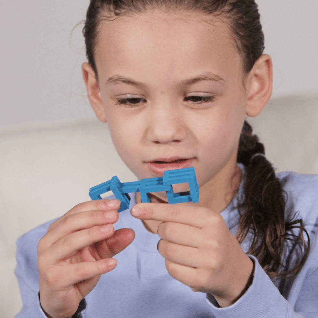 Little girl playing with a single set of OTO Jr. Fidget Blocks