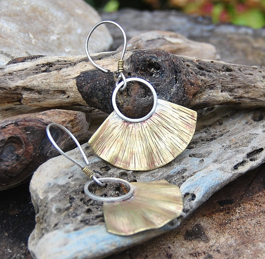 Sterling silver and brass fan earrings.