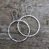 Sterling Silver hammered hoops.