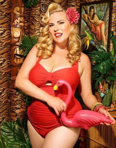vibrant red 1950s retro vintage style swimsuit with tummy control and ruching modelled by Amy Jones with flamingo