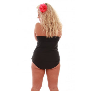 woman wearing black ruffles halterneck tankini top facing away from camera