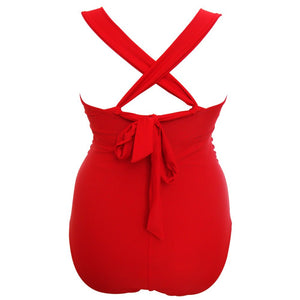 vibrant red 1950s retro vintage style swimsuit with tummy control and ruching side when tied as traditional or cross back