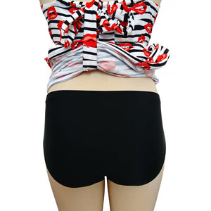Longer length tankini set/ swimdress with funky alt lips pattern in black white and red back on mannequin showing bottoms