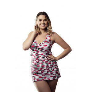 Woman facing camera wearing longer length tankini set/ swimdress with funky alt lips pattern in black white and red