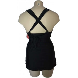 Black longer length 1950s retro style tankini shown on mannequin side back as cross back