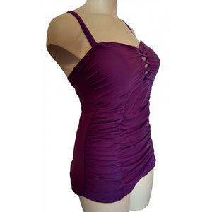Longer length vibrant purple lattice cleavage detail with ruching and adjustable straps side front on mannequin