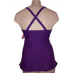 Longer length vibrant purple lattice cleavage detail with ruching and adjustable straps cross back style on mannequin  back