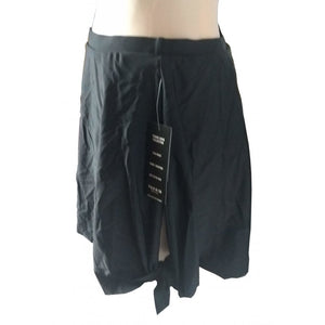 Black Skater assymmetric swim skirt tie side detail side with knot detail on mannequin