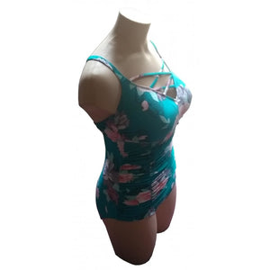 Teal retro vintage floral swimsuit with strappy neckline on mannequin side view