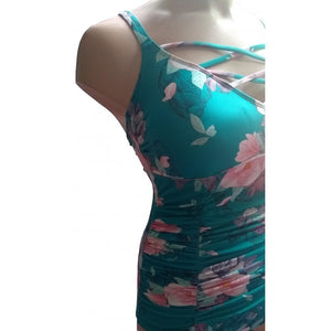 Teal retro vintage floral swimsuit with strappy neckline on mannequin front closeup