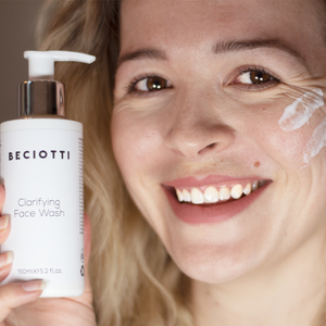 Beautiful lady unsing the luxurious revitalising effective nourishing clarifying face wash