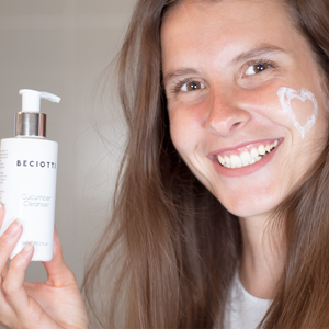A beautiful lady using the hydrating soothing cucumber cleanser with vitamin K & B5