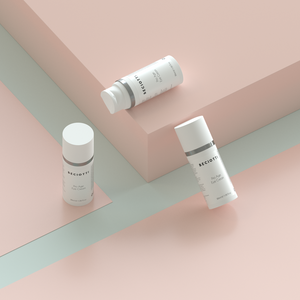3 of the  luxurious Pro-Age eye cream  placed nicely and minimalist background with pastel colours
