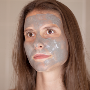 A beautiful lady using the anti-aging green tea face mask