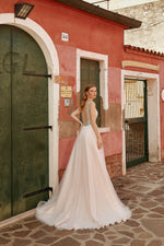 Penelope, A line wedding dress with tulle slit skirt  This A-line dress features a front keyhole bodice decorated with beads and lace. A sassy slit in the side of the sparkling tulle skirt reveals the leg for a flirty romantic look.