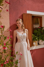 Ines, A-Line Embroidered Wedding Dress, Bohemian & Boho Bridal Gown with Sweetheart Neckline and Sparkling Skirt  This chic A-line dress has a unique pleated organza skirt with a layer of shiny sparkles. The beaded bodice with lace appliques showcases a soft sweetheart neckline. Delicate spaghetti straps and fabric covered buttons completes the romantic look.