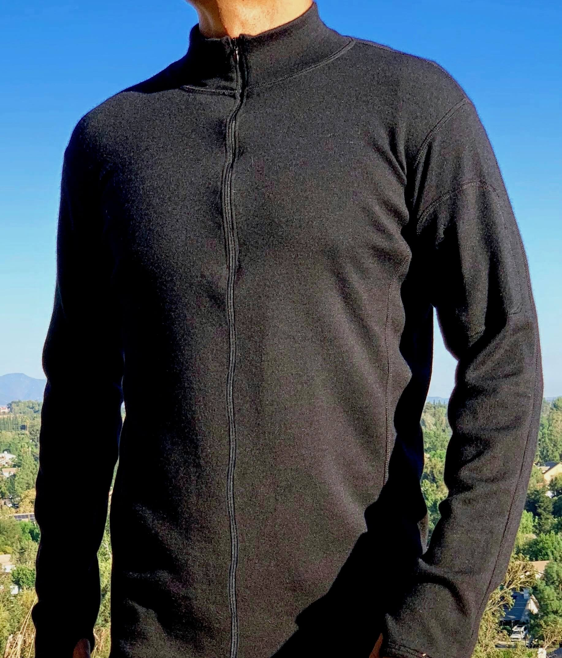 Man wearing alpaca wool base layer full zip neck on sunny day