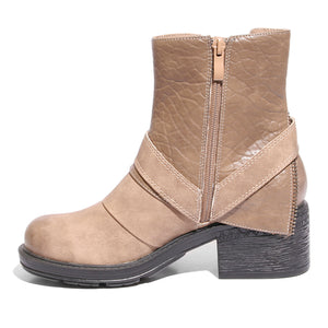Inside side view mixed media grunge taupe bootie with side zipper