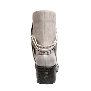 White back view mid-heel bootie with zipper closure and sole material rubber