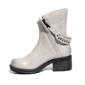 White inside side view mid-heel bootie with zipper closure and sole material rubber