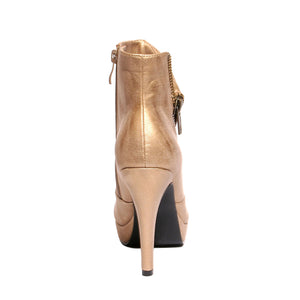 Back view champagne color stylish platform bootie with asymmetrical zipper detail