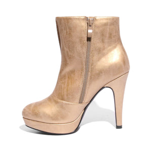 Inside side view champagne color stylish platform bootie with asymmetrical zipper detail