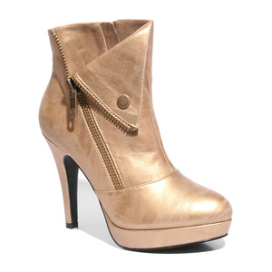 Three quarter view champagne color stylish platform bootie with asymmetrical zipper detail