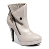 Three quarter view ice color stylish platform bootie with asymmetrical zipper detail