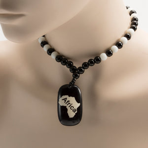 African Map Pendant On Black And White Beads Necklace