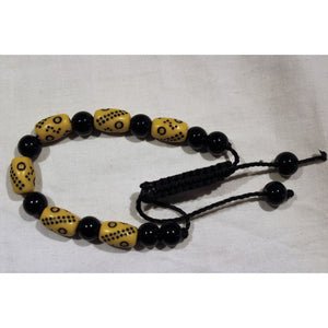 African Black & Cream Beads Bracelet With Cultural Carving