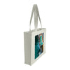 Side view of a medium tote bag featuring aerial photography of Bondi Icebergs Pool