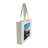 Side view of a medium tote bag featuring sunrise photography over Sea Cliff Bridge