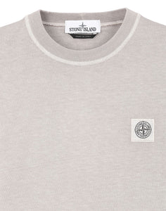 FISSATO' DYE TREATMENT: Short-sleeve crewneck T-Shirt in cotton jersey. Garment-dyed using the 'Fissato' effect: a water-soluble resin treatment and garment dyeing process creating a three-dimensional appearance. Ribbed neckline. Stone Island Compass patch logo on chest. 100% Cotton