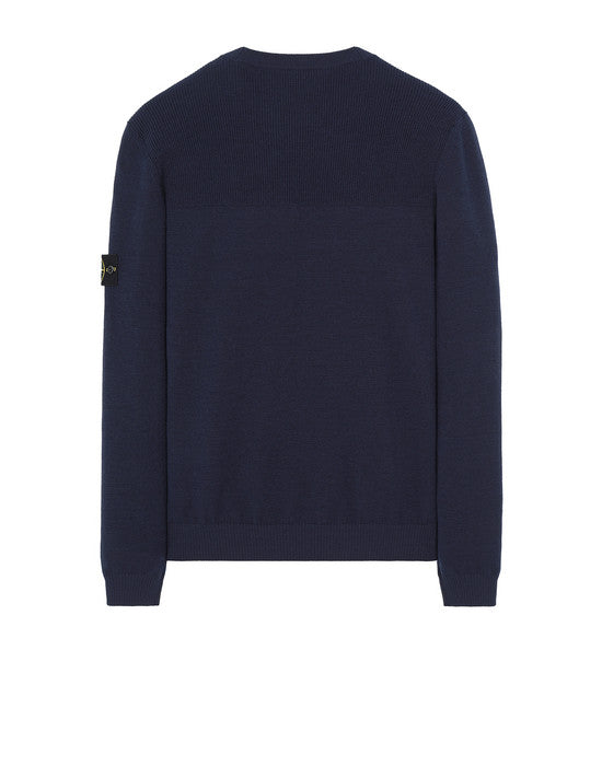 Crewneck knit in stretch wool. Plain stitch, with ribbed yoke on back. Ribbed cuffs and bottom band.