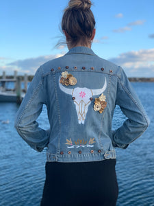 Handmade one of a kind denim jacket. Reclaimed and repurposed.  Western Animal Skull Flowers Wooden Beads Hand painted