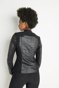 Designed for the bold, the Loretta Perforated Leather Women's Travel Jacket is the perfect elevated essential to add to any travel-ready collection. This stylish piece features a timeless slim fit with a high collared neckline and a snap-button closure. Perforated leather throughout adds an edgy feel to this wear-anywhere design, pairing perfectly with stretchy and cozy fleece panels and designer seaming for a slimming and sophisticated design that can take you anywhere.