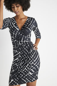 Hello Marine! Meet the most flattering, easy-to-wear and easy-to-care for women's travel clothes staple. Our Marine Wrap Dress flatters many body-types and best of all, no dry-clean needed. This form-fitting dress is the perfect travel-ready piece to have you looking poised and confident, whether jet-setting for fun or for business. Our sleek travel dress features a modern ruched wrap-front design with a slimming v-neckline and an above-the-knee length for a figure-flattering silhouette. Made in Italy using