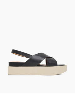Leather crossover platform sandals, the Serena wedge features an elasticated slingback strap, crossover straps to the front, and a creamy white platform sole.