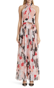 Gathered straps crisscross over the halter neckline of this sweeping maxi dress patterned with a colorful tropical print. This festive style is sewn from Fuzzi's signature mesh tulle that travels well thanks to its wrinkle-resistant and shape-maintaining properties.